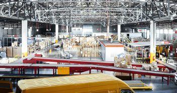 Big warehouse and trucks